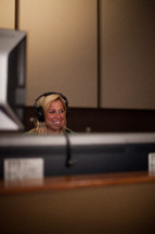 A smiling soundboard operator.