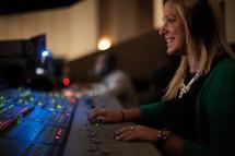 A smiling soundboard operator.