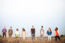 group of people walking in a field