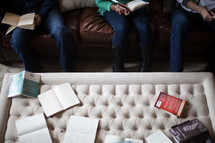 Bibles, journals, and books on a coffee table at a Bible study