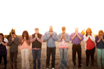 group, prayer, praying hands, heads bowed, man, woman, African American, outdoors