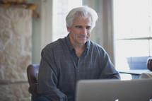 man working at a laptop