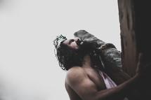 Jesus bearing the cross in agony