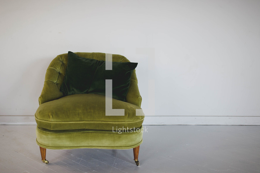 green chair and throw pillow
