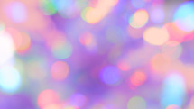 light and bright, colorful bokeh effect on purple, a festive, upbeat background