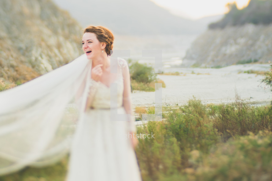 a young bride posing outdoors