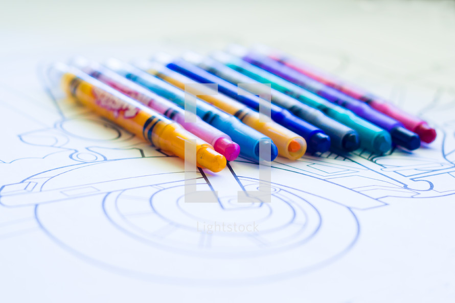 Crayons on a coloring sheet