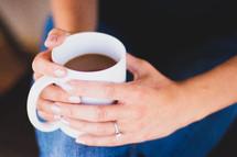 a woman holding a mug