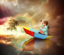 a child floating in a rainbow colored umbrella