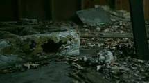 debris on the floor of an old warehouse