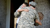 military family hugging