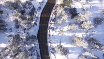 aerial view above snow and road