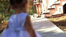 ring bearer and flower girl walking