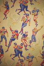 a wall with vintage sports wallpaper