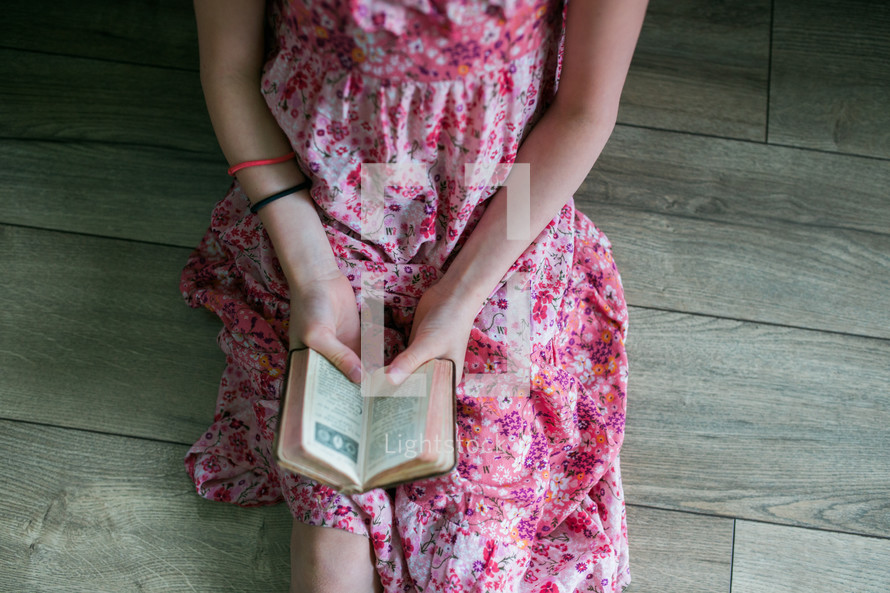 girls reading from old Bibles