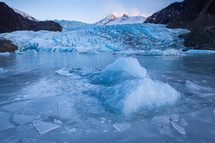 Frozen lake and icebergs in front of Mendenhall Glacier in Juneau, Alaska.
