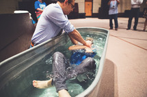 adult baptism, dunked in water