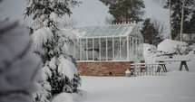 a greenhouse in winter snow