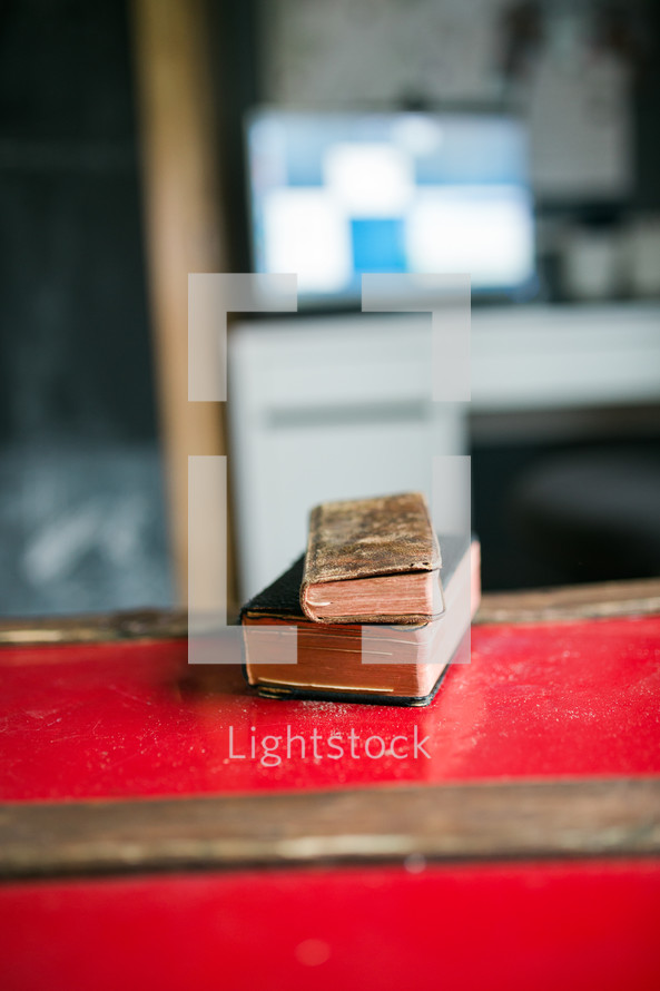 stacked books on a desk
