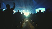 audience worshiping at a conference concert