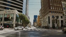 time-lapse of cars and pedestrians moving on city streets and sidewalks