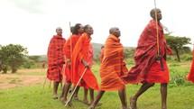Maasai warrior jumping and dancing