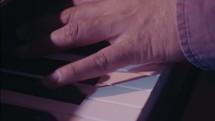 a man playing a digital keyboard