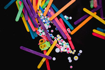 craft materials on a black background
