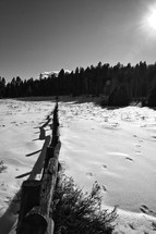 snow and a fence line