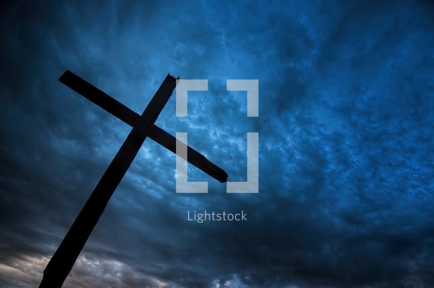 Cross against dark stormy sky