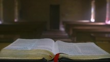 Bible on an alter in an empty chapel