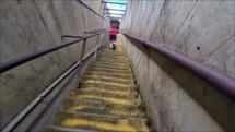 a boy running up steps
