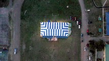 drone flying over large tent set up for an outdoor worship service in the Philippines