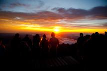 Standing on mountain watching sunset