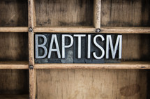 word baptism in blocks on a shelf
