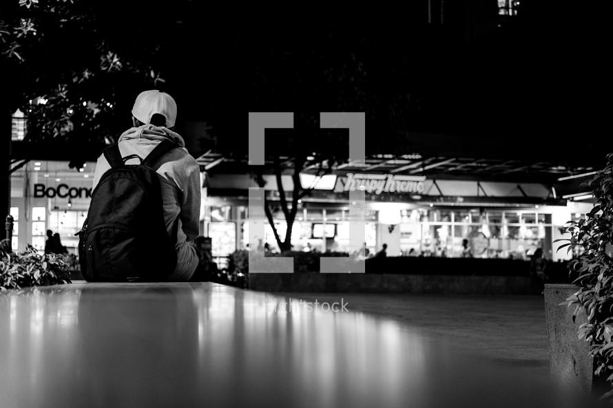 teen waiting at a mall