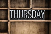 word Thursday in blocks on a shelf