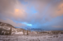 Rocky Mountains landscape scene at cloudy sunset in Colorado with trees and road
