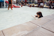 a little girl wadding in shallow water