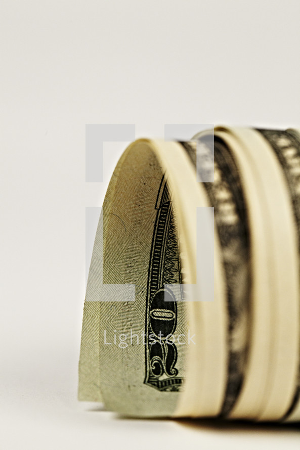 Twenty dollar bills rolled up