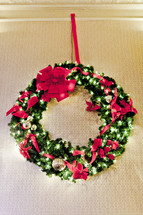 Christmas wreath with lights and ribbons
