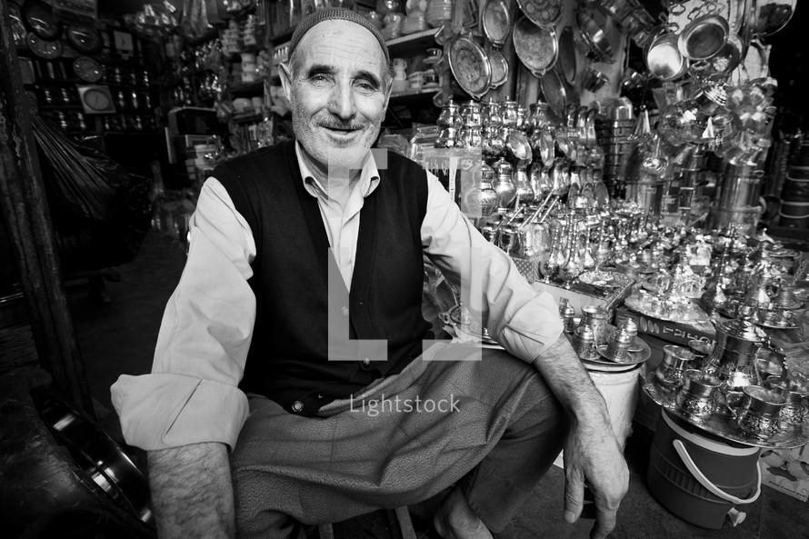 man in a silver shop