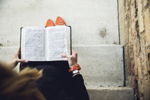 a pregnant woman reading a Bible