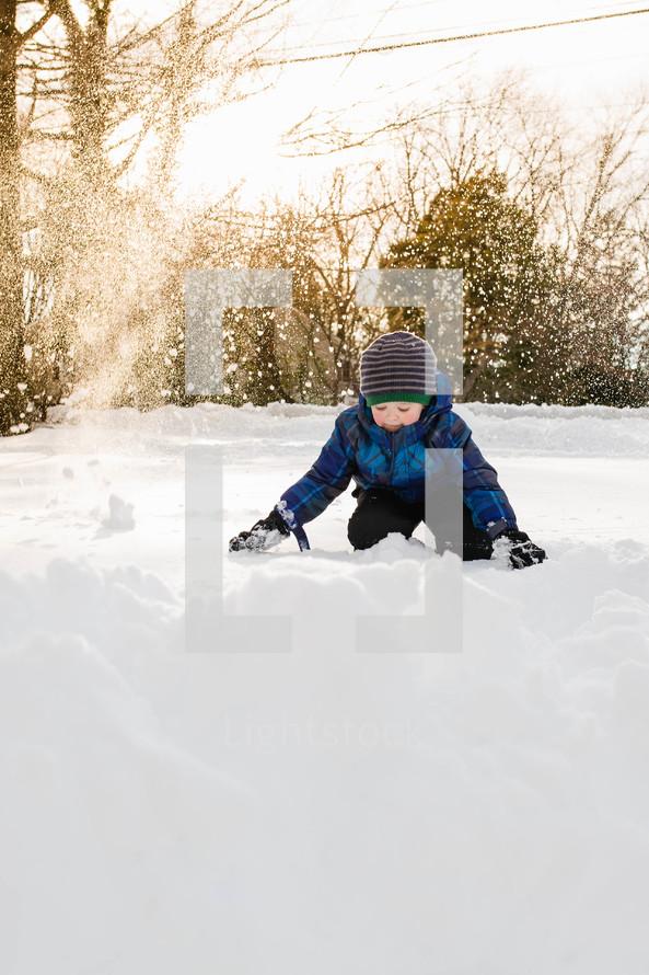 boy child playing in snow