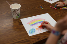Child coloring religious artwork