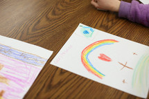 a child coloring religious artwork