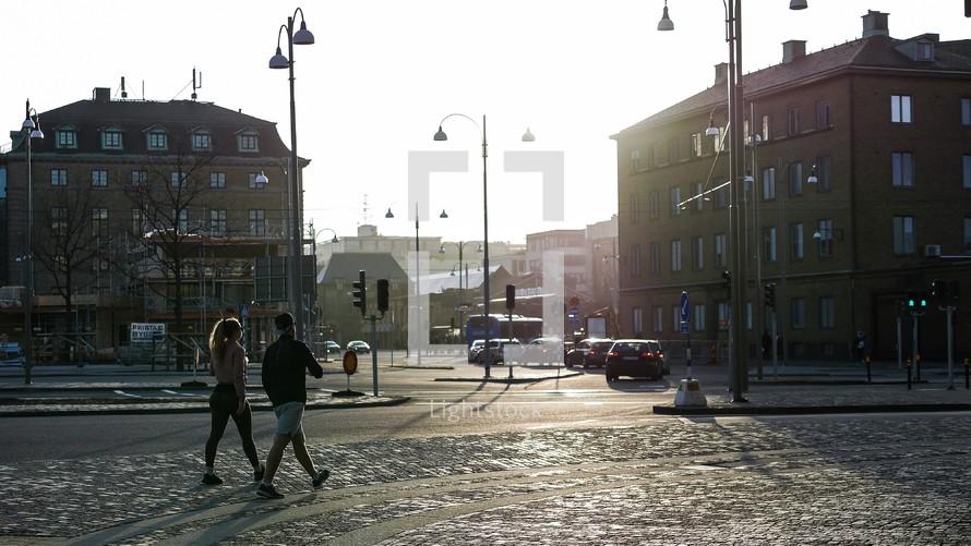 pedestrians on a cobblestone sidewalk in Sweden