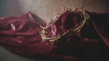 purple fabric and crown of thorns