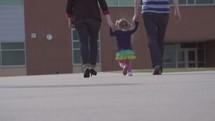 a family entering a brick building