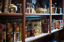 shelves filled with canned goods and tin pans - clean out your pantry